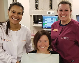 Progressive Dental staff with the Mother's Days Makeover Winner