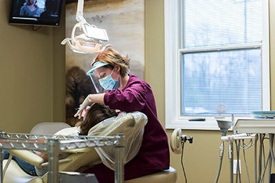 Hygienist working on a patient