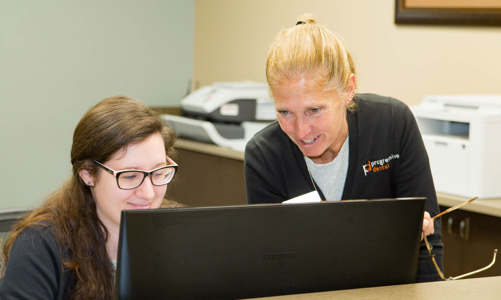 Progressive Dental staff working on the computer