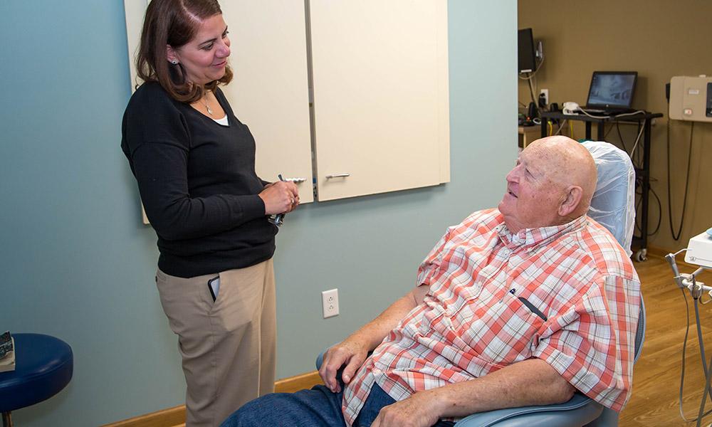 Dr. Jen talking with a patient