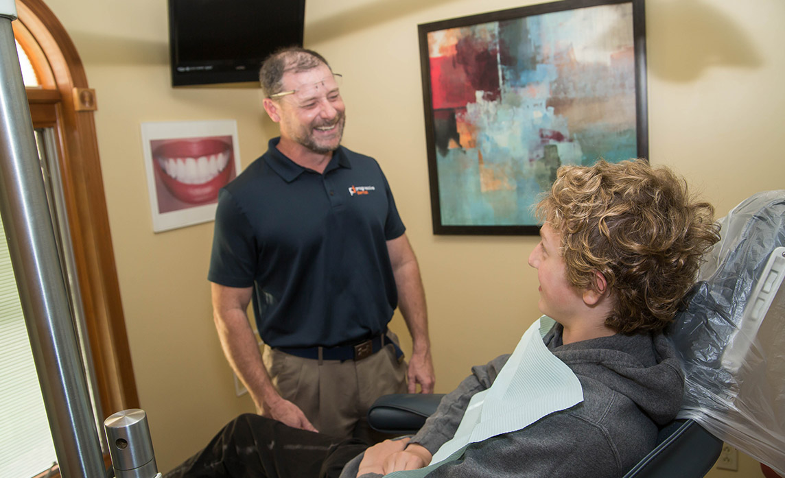 Dr. Blanchard smiling talking with a patient
