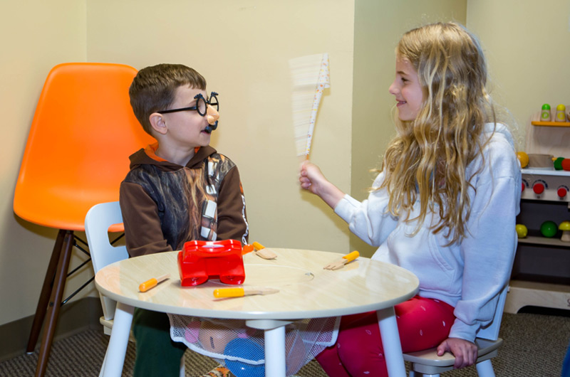 Two children playing in the Progressive Dental waiting room
